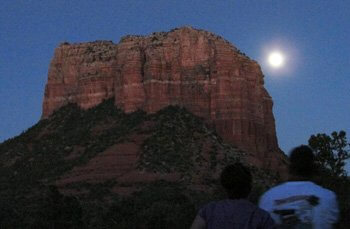 People observing the full moon rising over a Sedona butte--photo by Sandra Cosentino at one of our outdoor seminars in nature with solo vision circle..