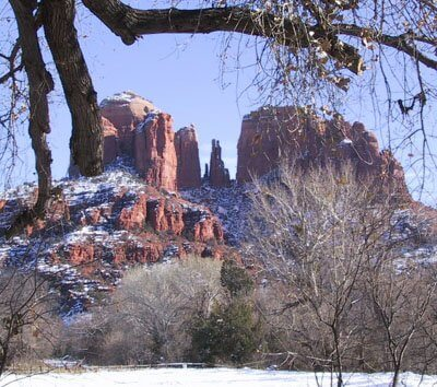 Cathedral Rock spires with snow; represents the Sedona winter quiet time
