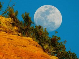Full moon rising over red cliff in Sedona. The moon and stars evoke awe and wonder in our Sedona outdoor circles and during the solo vision circle experience..