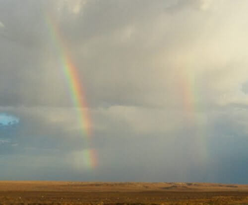 Double rainbow photo over the open brown Hopi landscape is a positive sign of moisture.