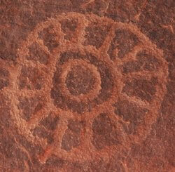 Ancestor rock art showing a ceremonial wheel. This symbolizes the Circle of Power Drum Healing Ceremony.