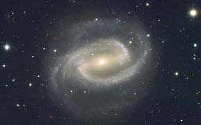 Spiral galaxy with dark sky and stars in background