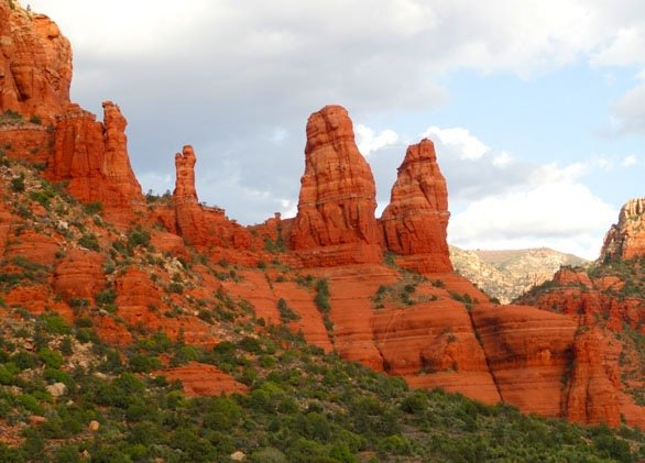 photo of 4 Sisters red rock formation, Sedona. Symbolizes an inspiring sacred site.
