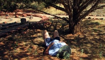 photo of a woman laying on the Earth symbolizes connecting with nature on Earth Day.