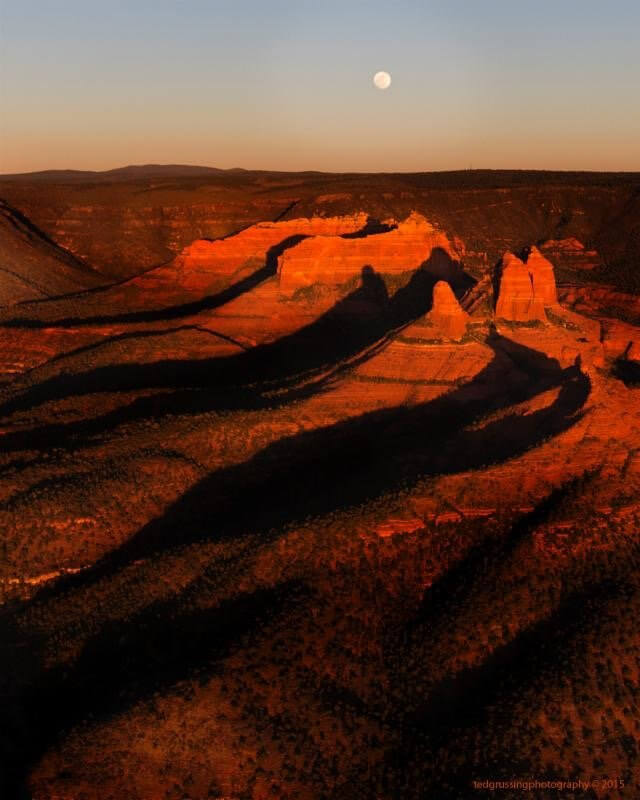 Sedona red buttes aerial view at sunset evokes calling of the high desert open spaces for spiritual connection.