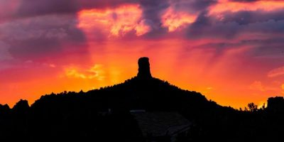 Vivid red-orange-purple sunset behind Chimney Rock in Sedona by Monica Parsley. One of the views from our sunset and moon circles.