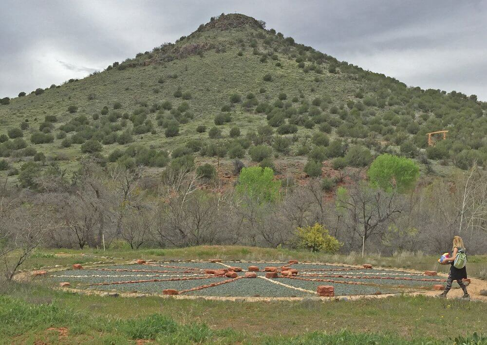 Medicine Wheel with cone shaped peak in background.