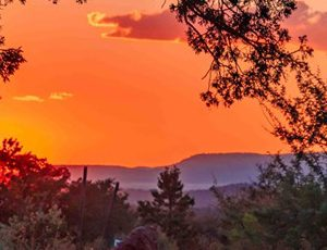 Sunset from a Sedona trailhead location shows the setting at the beginning of the full moon spiritual circle in nature.